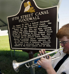 """17-year Doyle Cooper plays """"A closer walk with thee"""" at the close of Levees.org's Dedication Ceremony for a State Historic Plaque. © Photo/Judi Bottoni)"""