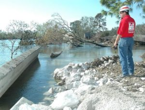 U.S. Army Corps of Engineers' Anthony Bertucci calls in the status of the floodwall at London Avenue Canal's upper breach near Robert E. Lee Boulevard. Bertucci is from New Orleans District's Construction Division.