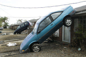 Katrina: Rear View Mirror. Cars were neatly deposited on the roofs of houses in Chalmette when the storm surge blasted through the community about 10 miles south of New Orleans///A street in Chalmette, Louisiana after Hurricane Katrina. Credit: Andy Levin/Polaris