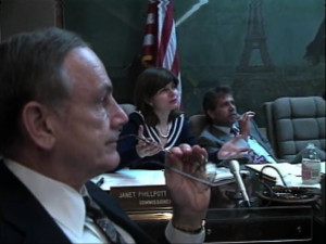 Scene from Orleans Levee Board meeting, May 30, 1991. From right to left, Congressman Senator J. Bennett Johnston, OLB commissioner Janet Phillpott and Robert Ramelli. WDSU Channel 6 archives